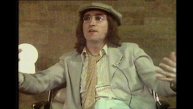 john lennon, speaking in 1975, on how he has suffered from periods of depression all of his life including at the height of the beatles fame; 'i go... - anno 1975 video stock e b–roll