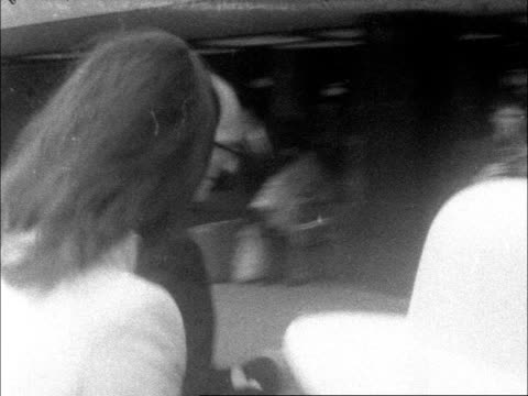 john lennon yoko ono leave lap england london heathrow ms john and yoko along inside lr to bv neg 16mm brenards 20 secs 12 ft tx 25469/550pm - john lennon stock videos and b-roll footage