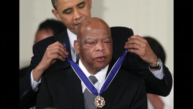 stockvideo's en b-roll-footage met john lewis, the non-violent civil rights warrior who marched with martin luther king jr and nearly died from police beatings before serving for... - congreslid