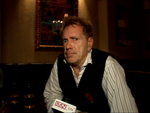 john lydon interview and press conference at launch of computer game; england: london: int john lydon interview sot - on being jet lagged - on his... - burping stock videos & royalty-free footage
