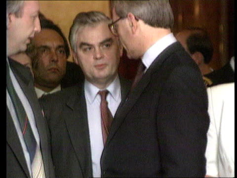 int ms john major norman lamont standing together as chatting lms major lamont towards from building - john major stock videos & royalty-free footage