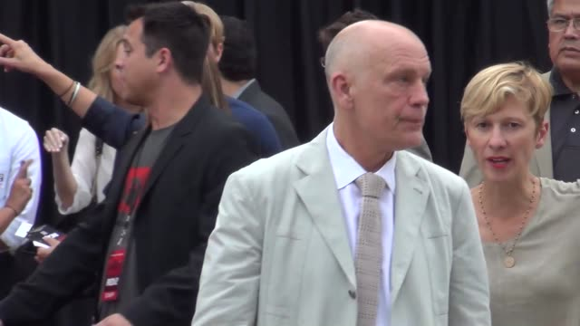 John Malkovich greets fans at the Westwood Village Theatre in Westwood 07/11/13 John Malkovich greets fans at the Westwood Village on July 11 2013 in...