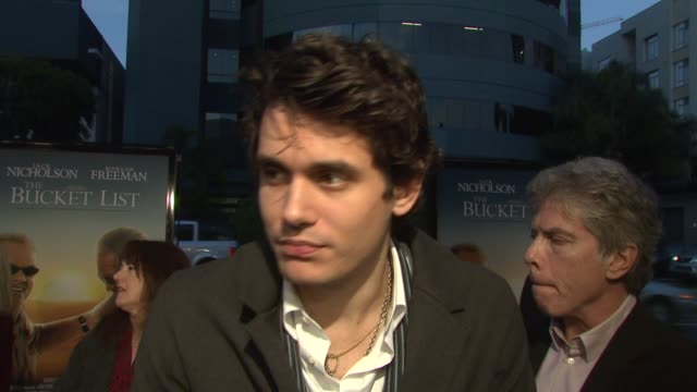 john mayer on his involvement in the movie, and the meaning of his song 'say' from the film at the 'the bucket list' premiere at the cinerama dome at... - bucket list stock videos & royalty-free footage