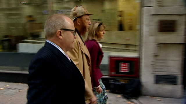 stockvideo's en b-roll-footage met john mccririck appears at employment tribunal london mccririck wife jenny and another arriving for employment tribunal hearing where mccririck is... - john mccririck