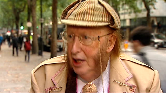 john mccririck interview and talking to media england london ext john mccririck interview sot / mccririck talking to journalists - john mccririck stock videos & royalty-free footage