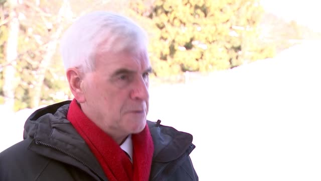 John McDonnell interview at Davos SWITZERLAND Davos EXT John McDonnell MP interview SOT John McDonnell MP waiting then into 'golf cart' electric car...