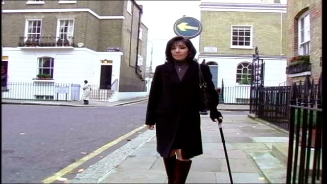 probation service criticised; tx chelsea: ext homeyra monckton towards using a walking stick to help her walk - probation stock videos & royalty-free footage