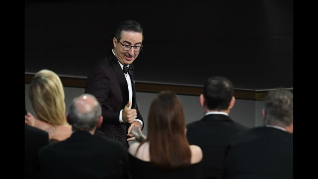 vídeos de stock, filmes e b-roll de john oliver accepts the outstanding variety talk series award for 'last week tonight with john oliver' onstage during the 70th emmy awards at... - 70th annual primetime emmy awards