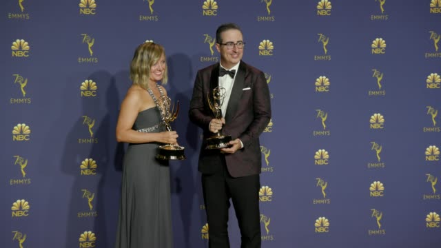 John Oliver and Liz Stanton at the 70th Emmy Awards Photo Room at Microsoft Theater on September 17 2018 in Los Angeles California