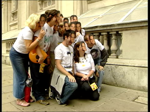 Chart success ITN ENGLAND London Pop star Gareth Gates fans outside Downing Street gates wearing Gareth Gates masks Police approaching fans Fans...