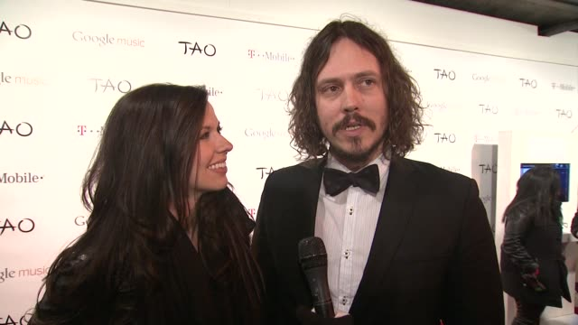john paul white and joy williams on google music and on music being available anytime anywhere at tmobile presents google music at tao day 4 in park... - google brand name stock videos and b-roll footage