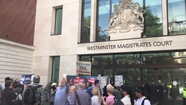 john pilger, a friend of julian assange joins supporters outside westminster magistrates' court. mr assange is expected to appear via videolink as he... - john pilger stock videos & royalty-free footage
