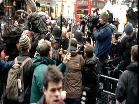 John Pilger talks to press outside Westminster Court where Wikileaks founder Julian Assange will appear