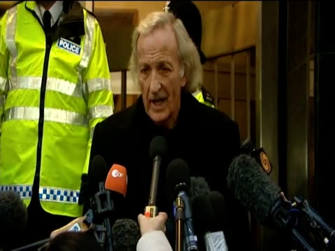 john pilger talks to press outside westminster court where wikileaks founder julian assange will appear - john pilger stock videos & royalty-free footage