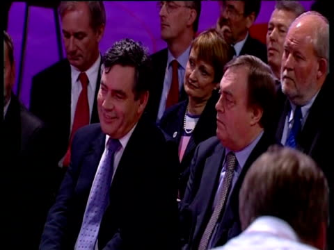 john prescott mp and gordon brown mp sit in audience of labour party conference and are applauded as prime minister tony blair praises their... - john prescott politiker stock-videos und b-roll-filmmaterial