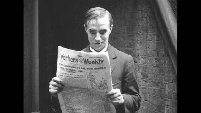 john ross campbell poses with a copy of the british communist newspaper workers weekly campbell published an article urging troops not to fire on... - 1924 stock videos and b-roll footage
