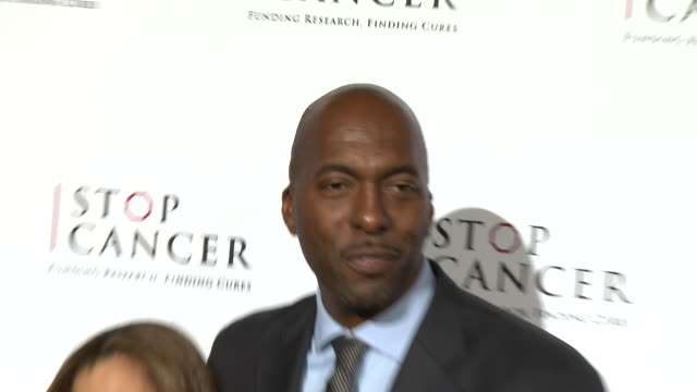 vídeos de stock, filmes e b-roll de john salley and natasha duffy at stop cancer annual gala honoring lori and michael milken at the beverly hilton hotel on november 23, 2014 in beverly... - the beverly hilton hotel