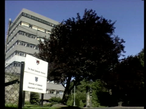 edinburgh royal informary section of hospital zoom in upper storeys ms hospital sign trees at entrance as building in b/g - southwest usa stock videos & royalty-free footage