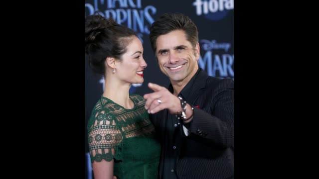 John Stamos and Caitlin McHugh arrive to the World Premiere Of Disney's Mary Poppins Returns held at The Dolby Theatre on November 29 2018 in Los...