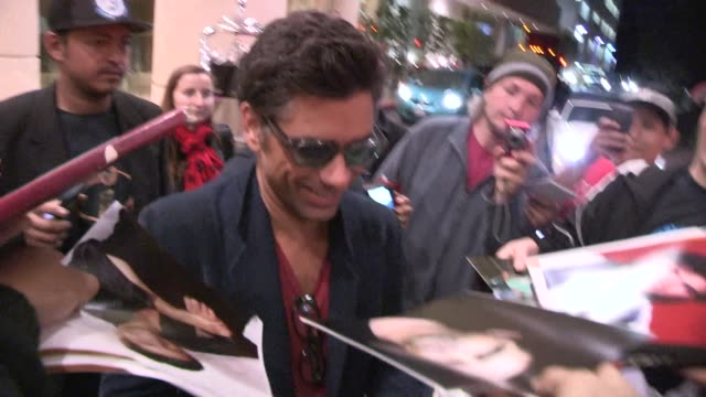 John Stamos greets fans at 'A Night At Sardi's' at The Beverly Hilton Hotel in Beverly Hills on March 26 2014 in Los Angeles California
