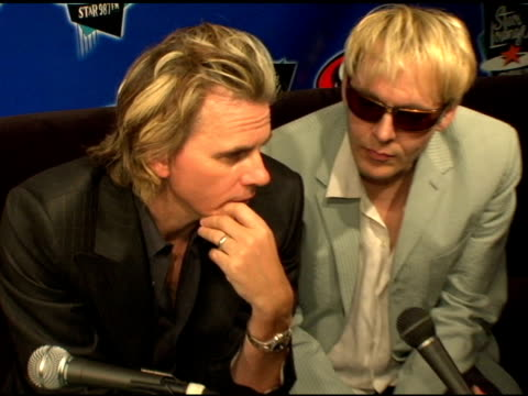 stockvideo's en b-roll-footage met john taylor and nick rhodes of duran duran at the duran duran debuts of their new single at star 987 fm radio in burbank california on august 19 2004 - duran duran