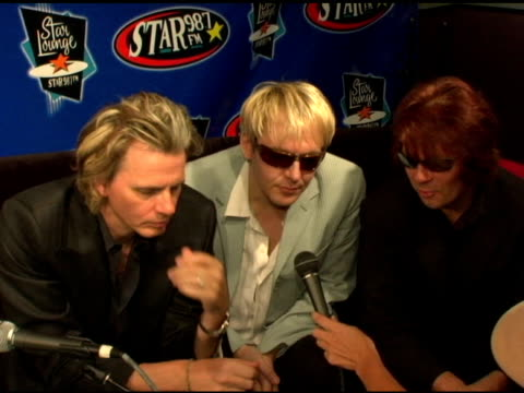 stockvideo's en b-roll-footage met john taylor nick rhodes and andy taylor of duran duran at the duran duran debuts of their new single at star 987 fm radio in burbank california on... - duran duran
