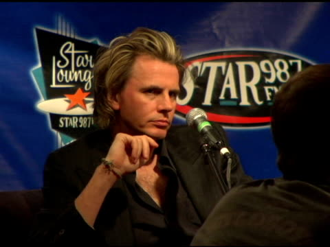 stockvideo's en b-roll-footage met john taylor of duran duran at the duran duran debuts of their new single at star 987 fm radio in burbank california on august 19 2004 - duran duran