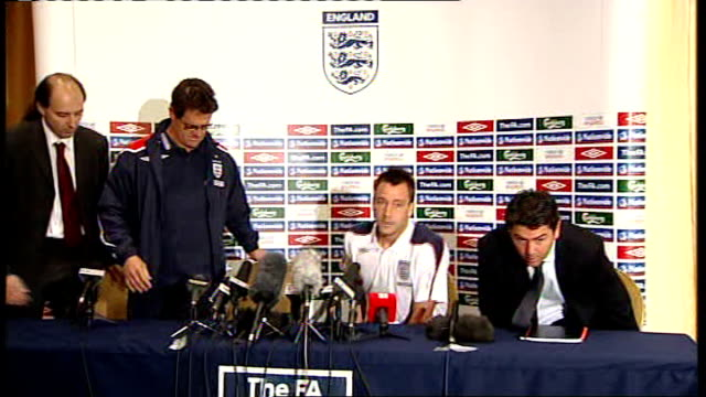 john terry and fabio capello arriving at press conference and taking seats john terry press conference sot it means the world to me to retain the... - arm band stock videos & royalty-free footage