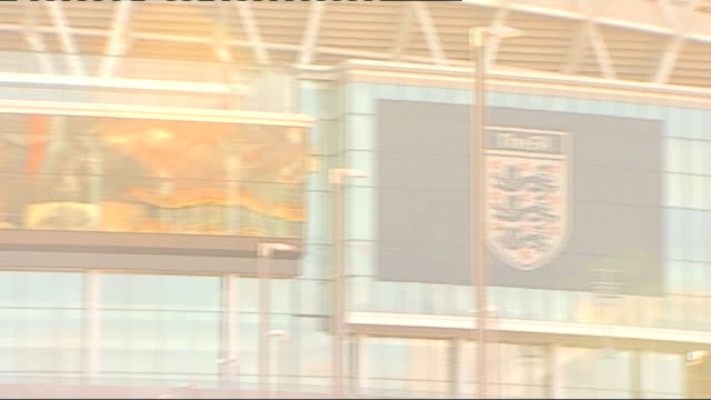 stockvideo's en b-roll-footage met john terry banned and fined by fa over anton ferdinand racial abuse; r03021214 / 3.2.2012 wembley stadium: along wembley stadium to 'the fa 'sign... - english football association