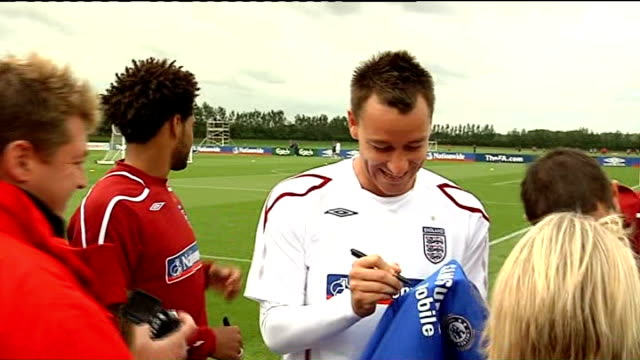 cobham training ground ext terry signing autographs at england training session - autogramm stock-videos und b-roll-filmmaterial
