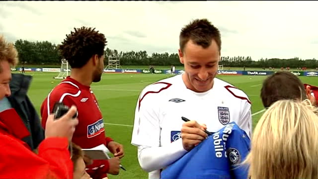 john terry reinstated as permanent england captain 522010 surrey cobham training ground ext john terry signing autographs at england training session... - cobham surrey stock videos and b-roll footage