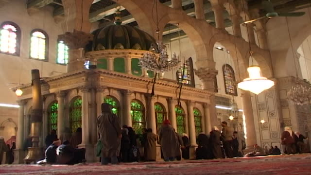 john the baptist shrine umayyad mosque lowangle view of the shrine which is said to enclose the head of john the baptist surrounded by worshippers - baptist stock videos & royalty-free footage