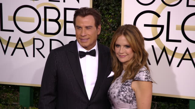 vídeos y material grabado en eventos de stock de john travolta and kelly preston at 74th annual golden globe awards arrivals at 74th annual golden globe awards arrivals at the beverly hilton hotel... - kelly preston