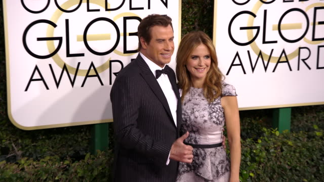 john travolta and kelly preston at 74th annual golden globe awards arrivals at 74th annual golden globe awards arrivals at the beverly hilton hotel... - kelly preston stock-videos und b-roll-filmmaterial