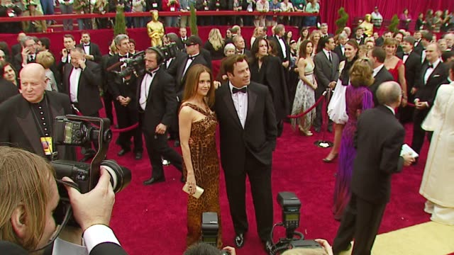 john travolta and kelly preston at the 2007 academy awards arrivals at the kodak theatre in hollywood california on february 25 2007 - kelly preston stock-videos und b-roll-filmmaterial