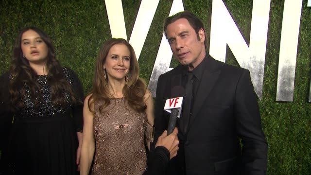 vídeos y material grabado en eventos de stock de interview john travolta and kelly preston at the 2013 vanity fair oscar party hosted by graydon carter interview john travolta and kelly preston at... - kelly preston