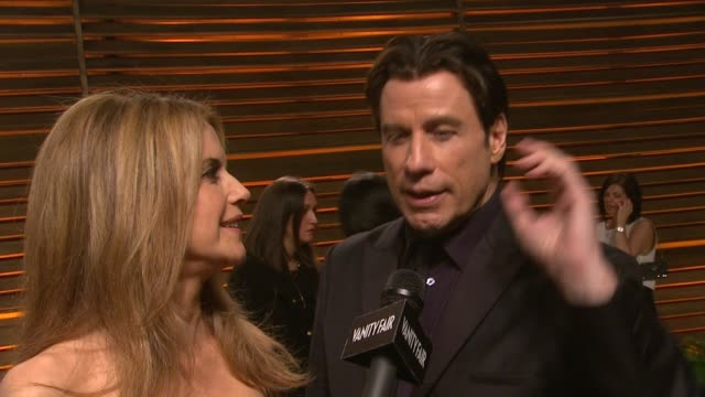 vídeos y material grabado en eventos de stock de interview john travolta and kelly preston at the 2014 vanity fair oscar party hosted by graydon carter arrivals on march 02 2014 in west hollywood... - kelly preston