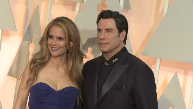 vídeos y material grabado en eventos de stock de john travolta and kelly preston at the 87th annual academy awards arrivals at dolby theatre on february 22 2015 in hollywood california - kelly preston