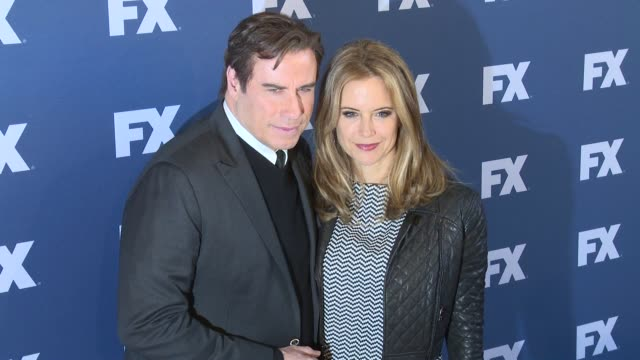 john travolta and kelly preston at the people v oj simpson american crime story fx networks upfront screening at amc empire 25 theater on march 30... - kelly preston stock-videos und b-roll-filmmaterial