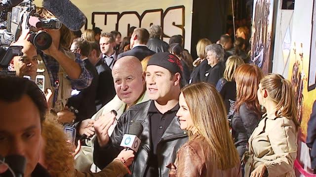 john travolta and kelly preston at the 'wild hogs' premiere at the el capitan theatre in hollywood, california on february 27, 2007. - el capitan kino stock-videos und b-roll-filmmaterial