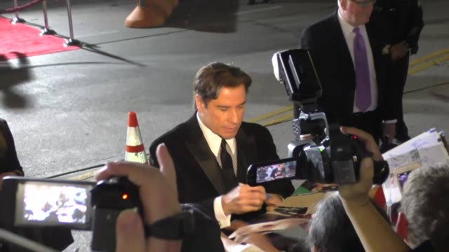 john travolta arriving to american crime story - the people v. o.j. simpson at village theatre in westwood in celebrity sightings in los angeles, - westwood village stock videos & royalty-free footage