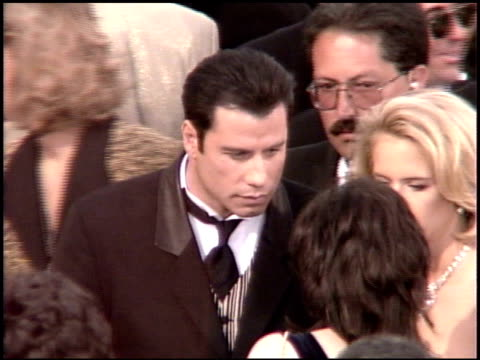 john travolta at the 1995 academy awards arrivals at the shrine auditorium in los angeles, california on march 27, 1995. - shrine auditorium 個影片檔及 b 捲影像