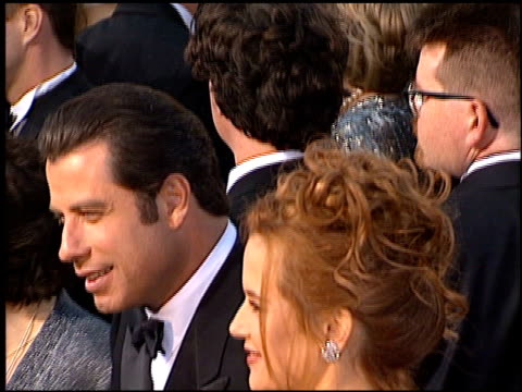 john travolta at the 1996 academy awards arrivals at the shrine auditorium in los angeles, california on march 25, 1996. - 第68回アカデミー賞点の映像素材/bロール