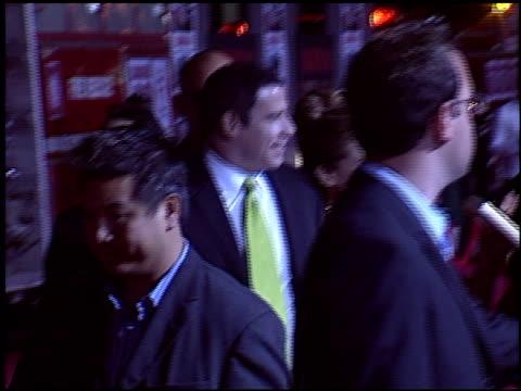 john travolta at the 'ladder 49' premiere at the el capitan theatre in hollywood california on september 20 2004 - el capitan kino stock-videos und b-roll-filmmaterial