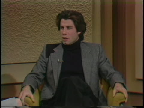 john travolta feels that the film is important because it speaks to what young men are going through throughout the world at this stage of their life. - music or celebrities or fashion or film industry or film premiere or youth culture or novelty item or vacations点の映像素材/bロール
