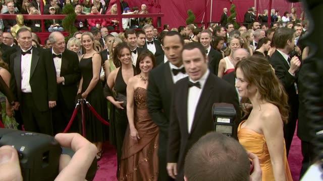 John Travolta Kelly Preston and Dwayne 'The Rock' Johnson at the 2008 Academy Awards at the Kodak Theatre in Hollywood California on February 24 2008