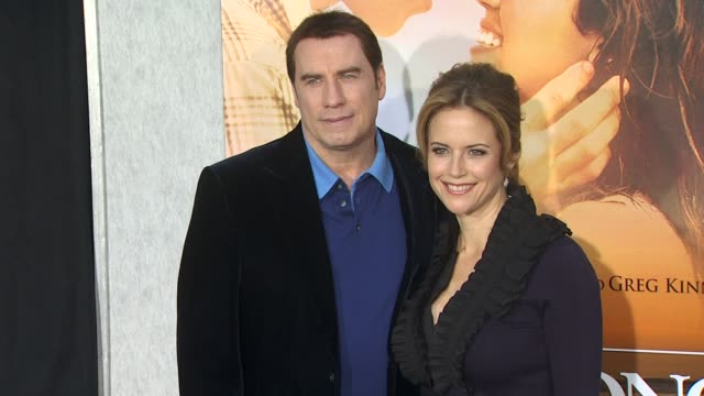 john travolta kelly preston at the 'the last song' premiere at hollywood ca - kelly preston stock-videos und b-roll-filmmaterial