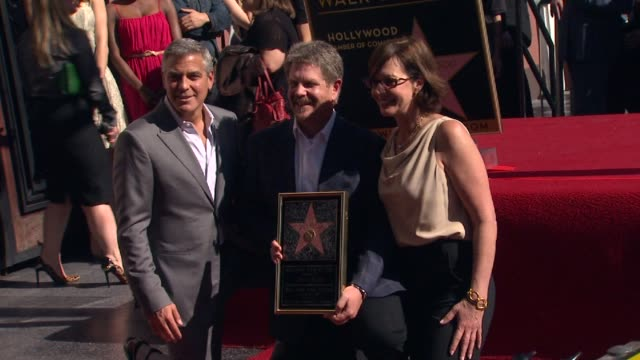 John Wells George Clooney and Allison Janney at John Wells Honored With Star On The Hollywood Walk Of Fame on 1/12/12 in Hollywood CA
