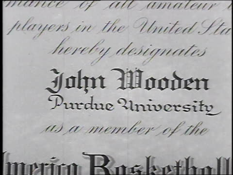 john wooden from purdue university is named to the all-american college basketball team / john wooden certificate / wooden dribbling and shooting.... - 1932 stock videos & royalty-free footage