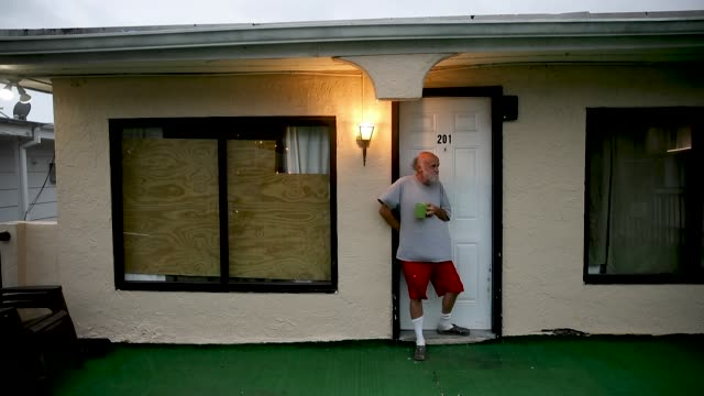 johnny caroll has his morning coffee as the winds from hurricane florence are felt on september 14 2018 in myrtle beach united states hurricane... - carolina beach stock videos and b-roll footage